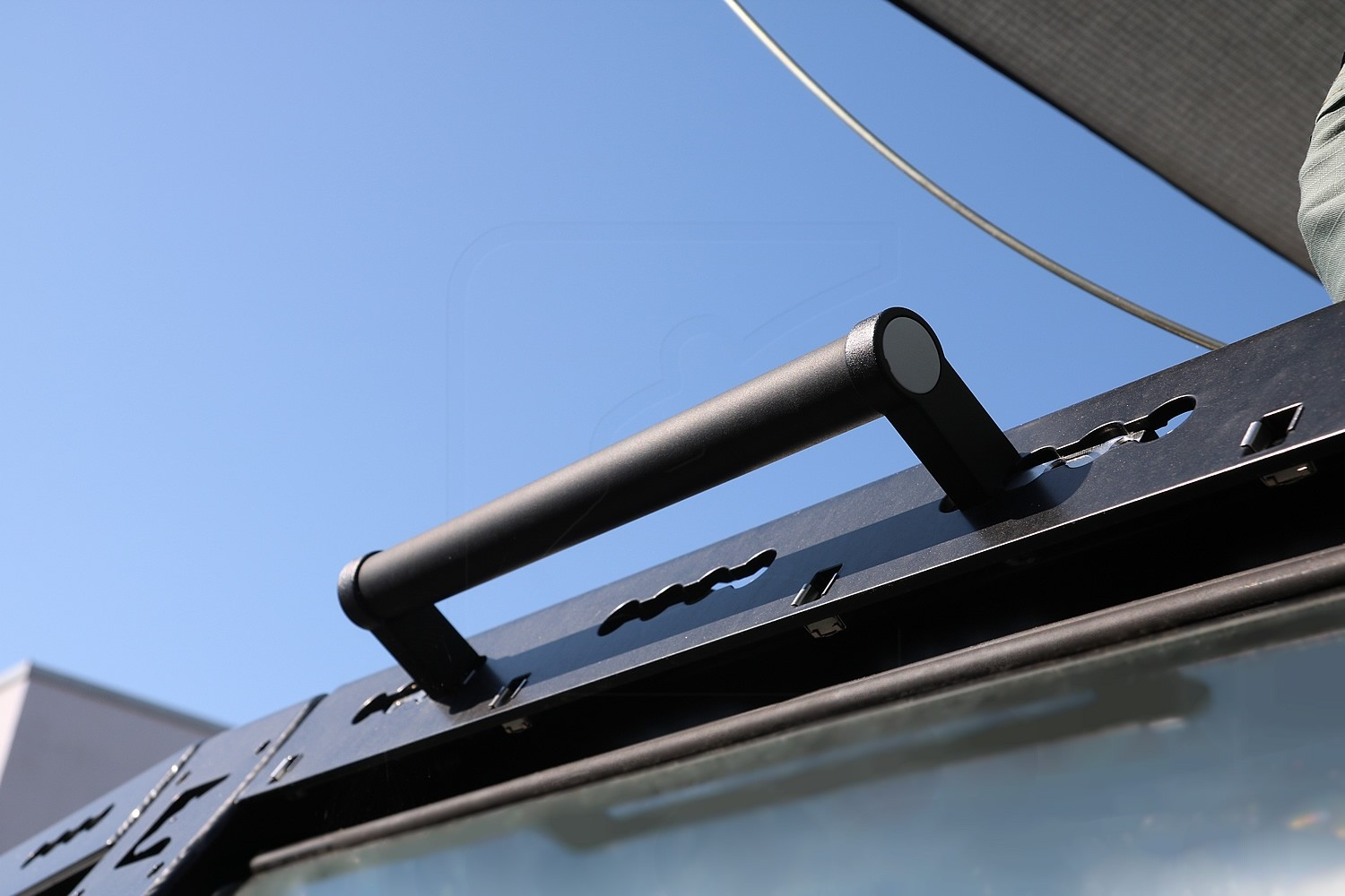 Handle for CargoBear system roof rack